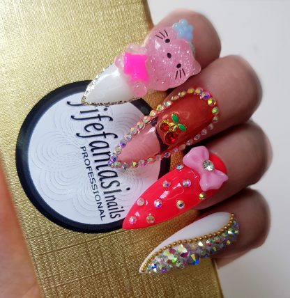 hello kitty pink long nails with crystals