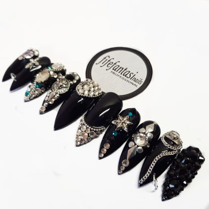 Black long stiletto nails, clear crystals, skulls, chains